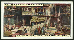 Riverside dwellings and sampans, China.