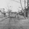Ramshackle Negro houses, muddy street, no sidewalks, in Fulton