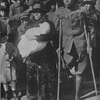 One of the wounded [a member of the famous 369th Colored Infantry] and his mother.