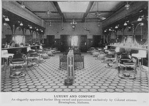 Luxury and comfort; An elegantly appointed barber shop owned and patronized exclusively by colored citizens, Birmingham, Alabama.
