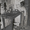 Corner of room of living quarters provided for Negro strawberry pickers near Independence, Louisiana, April 1939.