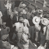 Negro day laborers brought in by truck from nearby towns, waiting to be paid off and buy supplies, for cotton picking inside plantation store, Friday night, Marcella Plantation, Mileston, Mississippi Delta, Mississippi, October 1939.