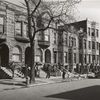 Old brown stonehouses now occupied by Negroes in Chicago, Illinois, April 1941.