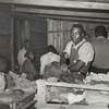 Negroes in bunkhouse in strawberry fields near Hammond, Louisiana; Note crude bunks, straw mattresses, and crowded conditions, April 1939.