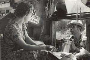 Negro making purchase at traveling general store near Forrest City, Arkansas, September 1938.