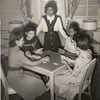 Government hotel for Negro women war workers; A group of young war worker-residents are shown enjoying a game of cards in the fully equipped game room of the Lucy D. Slowe Residence Hall, first government constructed hotels for Negro women war workers in Washington, D.C., between Fall 1942 and April 1943.