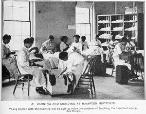 Darning and mending at Hampton Institute.