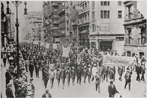 [Silent Protest parade on Fifth Avenue, New York City, July 28, 1917, in response to the East St. Louis race riot. In front row are James Weldon Johnson [far right], W. E. B. DuBois [2nd from right], Rev. Hutchens Chew Bishop, rector of St. Philip's Episcopal Church [Harlem] and realtor John E. Nail.]