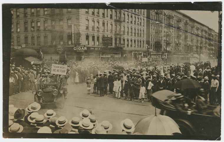 UNIA Parade, organized in Harlem, 1924; [One of the slogans carried in the parade; Harlem, corner of the 135th Street and Lenox Avenue.]
