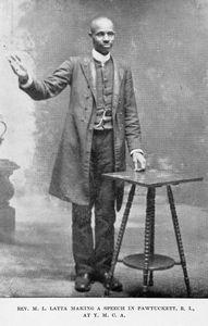 Rev. M. L. Latta making a speech in Pawtucket, R. I.; At Y.M.C.A.