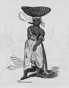 [Woman carrying a woven basket on her head smoking a cigar.]