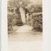 [Great Kills, Exterior, woman at front door.]
