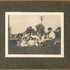 [Highbridge, Exterior, librarian and children on grass looking at camera.]
