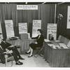 Library for the Blind, Exhibit Booth, American Libraries Association, San Francisco, CA. Left to right are: Mr. Charles Gallozzi, Assistant Chief, Division for the blind; Mr. Robert S. Bray, Chief, Division for the Blind; Miss Helga Leude, Librarian, American Foundation for the Blind