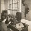 """A blind man adjusts the volume on a """"talking book"""" at the New York Public Library's Library for the Blind."""