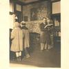 [New Dorp] Mr. Petersen's old office, formerly garage owned by Emil Peterson (6th Street) [Man reading standing and two young readers]