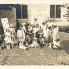 [New Dorp, Seated and costumed librarian with costumed children at story hour.]