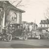 [Port Richmond] Staff member's Pontiac convertible, Reader's Ford, Mr. Krant, news dealer on sidewalk