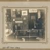 [West 40th Street - St. Raphael, Desk and framed pictures.]