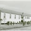 Negro children playing outside of nursery at Okeechobee migratory labor camps built by Farm Security Administration, Belle Glade, Florida, February 1941.