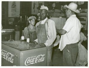 Mexican and negro cotton pickers inside plantation store, Knowlton Plantation, Perthshire, Miss. Delta. This transient labor is contracted for and brought in trucks from Texas each season. October 1939.