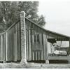 One of the sharecropper's houses with sweet potatoes and cotton on the porch; Knowlton Plantation, Perthshire, Mississippi Delta, Spring 1939.