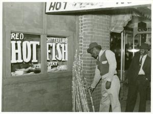 Chitterling, fish and sugar cane on street in Negro Section, Clarksdale, Mississippi Delta; On a Saturday afternoon, November 1939.