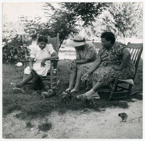 Two Negro supervisors and FSA [Farm Security Administration]borrower talk over the home problem. St. Mary's Co., Md.
