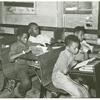 Negro school children studying near Southeast Missouri Farms, August 1938.