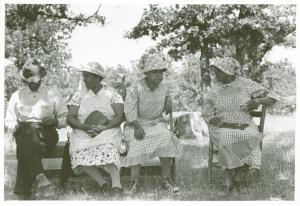 Negroes waiting outside a rural church while other members of their families are attending a church business meeting, McIntosh County, Oklahoma.