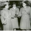 African American women basketball players holding their trophy won at the WAC Theater Basketball Championship in Rouen, France