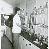 African American Private First Class Alfred Pierce, Jr., a laboratory technician at Fort Ord, California, holding a test tube