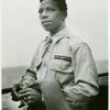 African American war correspondent aboard a U.S. Coast Guard ship