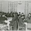 African American wounded soldiers, sailors, marines and Coast Guardsmen sitting at tables and enjoying their Thanksgiving dinner, at Lucy D. Slowe Hall, Washington, D. C.