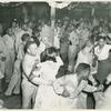 African American soldiers and their peer civilians dancing in the hall of a recreational facility.]