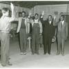 Induction station officer swearing in African American fathers and sons
