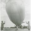African American soldiers holding a barrage balloon to demonstrate its operations in the Third War Loan Drive in Washington, D. C.