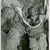 African American Staff Sergeant James O. Snowden wearing a parachute pack and waiting in line to jump out of a C-47 transport plane