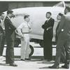A white P-80 pilot standing next to a plane and speaking to African American Marcus H. Ray, Civilian Aide to the Secretary of War, as four other African American men look on and listen, Army Air Forces Wright Field, Dayton, Ohio