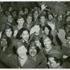 A crowd of African American Women's Army Corps members waving at the camera, Staten Island Terminal, New York Port of Embarkation