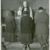 [An Episcopal Bishop confirming African American Lieutenants Rosemary Vincent and Hallie M. Brown and an unidentified soldier, as they kneel before him.