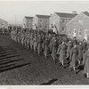 Members of an all-African American company walking in rows during an infantry drill at the First Women's Army Auxiliary Corps Training Center