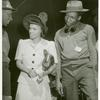 Elaine Mulzac, an African American woman, daughter of SS Booker T. Washington skipper, talking to two shipyard employees