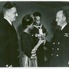 Mrs. Charles W. David, Jr.; African American widow and her three-year-old son, Neil Adrian receiving the Navy and Marine Corps Medal from Rear Admiral, Stanley V. Parker
