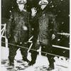 Two African American Navy officers, [left to right] Ensign J. J. Jenkins and Clarence Samuels, aboard a cutter on the North Atlantic patrol