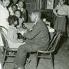 National Youth Administration youth assisting doctor in medical examination of children at the St. Simon's Center, Philadelphia, April 2, 1941.