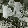 African American woman testing nuts and bolts