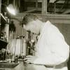 African American man looking into a microscope at the medical unit of the Astoria Work Experience Center