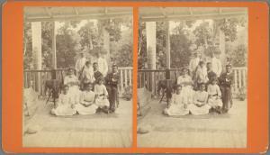 [Family portrait on porch.]