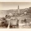 [Views of a church, bell tower, and remains of ancient buildings in the foreground.]